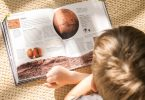 Boy reading a book about Mars