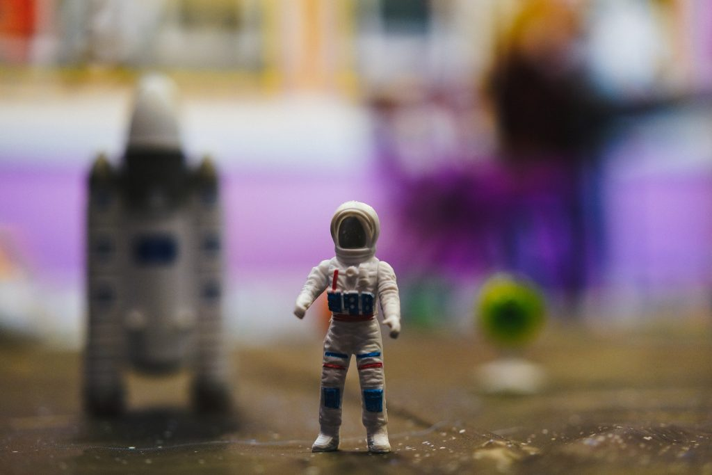 Toy Astronaut with blurred background photo